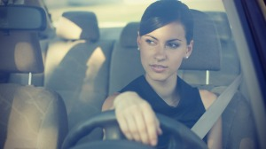 Businesswoman driving in an air conditioned vehicle