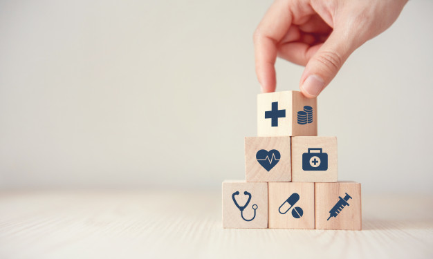health-insurance-concept-reduce-medical-expenses-hand-flip-wood-cube-with-icon-healthcare-medical-coin-wood-background-copy-space_52701-34